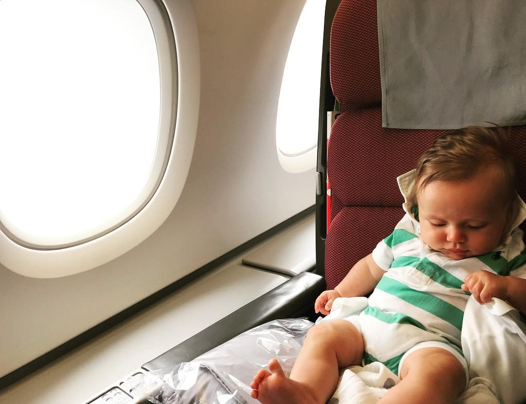 Baby on airplane seat