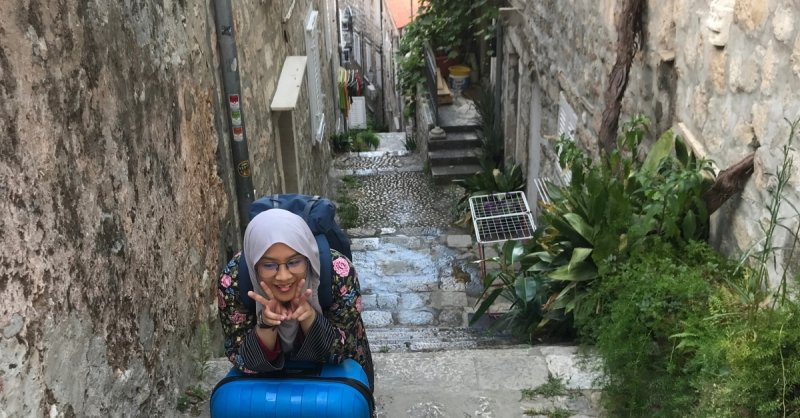 girl with suitcase in croatia