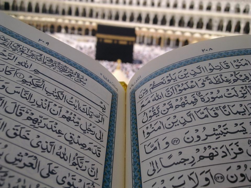 quran with kaaba in the background