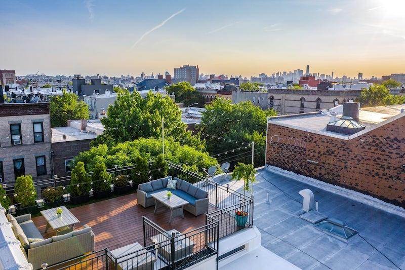 View of Manhattan skyline from rooftop in Queens