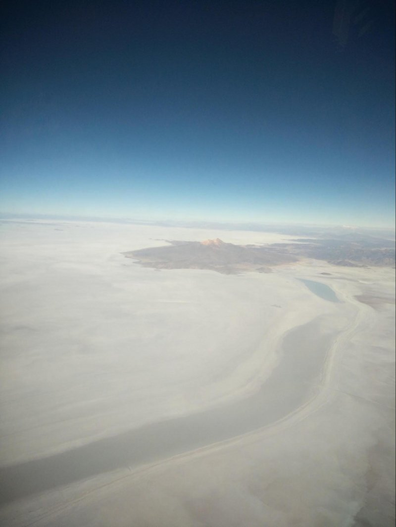 Salar de Uyuni is so vast that its 4,000 square miles of barren, salty crust can be seen from space. Due to its colour, it resembles a snowy glacier when ...