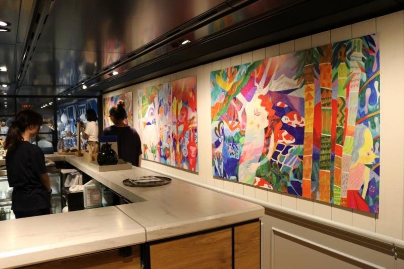 artwork displayed on walls of genbi shinkansen