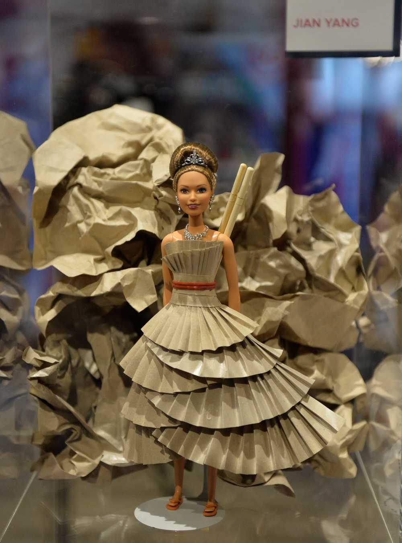 Barbie in Singapore-style cardboard dress