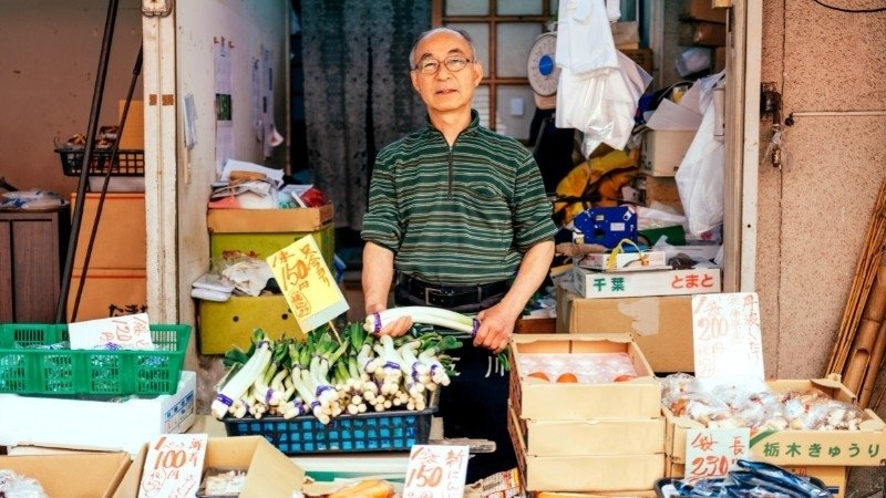 Japanese vendor selling vegetables and seafood in Japan