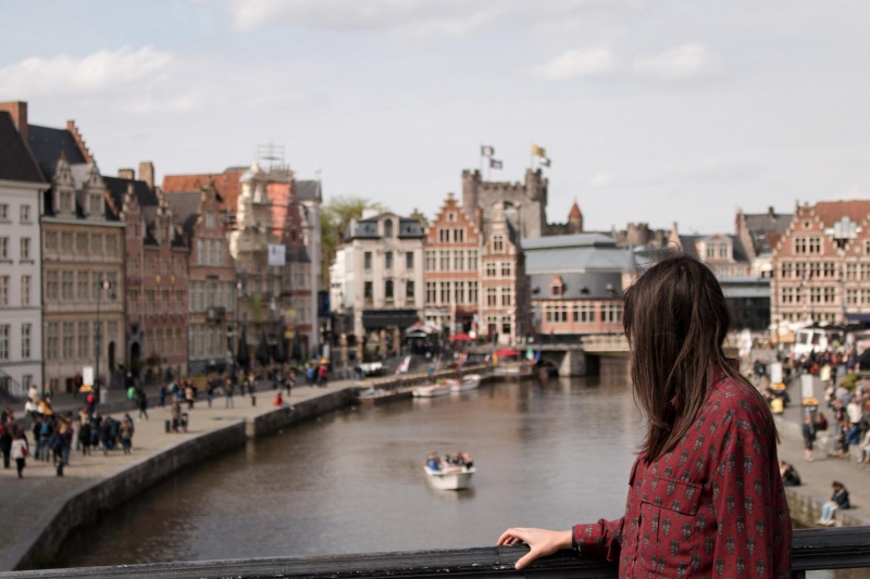 backview of woman looking out to canal