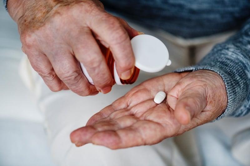 person taking medicine