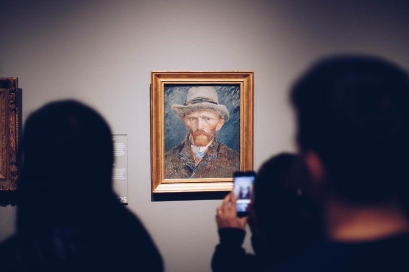 people viewing van gogh portrait