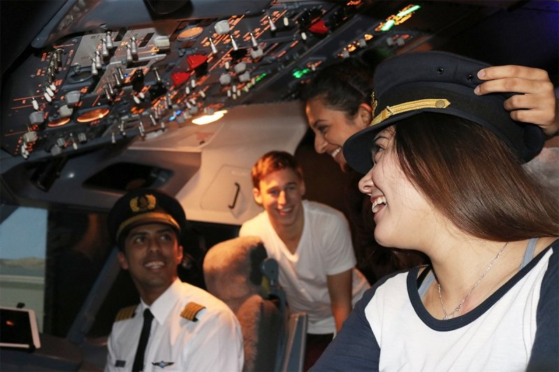 teenagers in the flight simulator