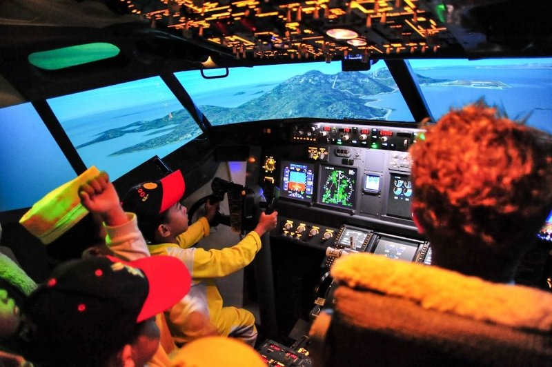 child taking off in the flight simulator