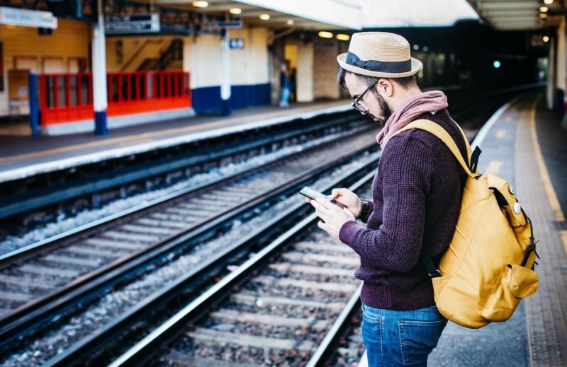 Traveller using phone