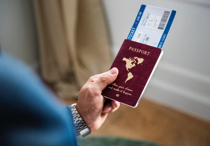 Passport and flight ticket
