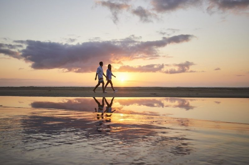 couple strolling on the beach