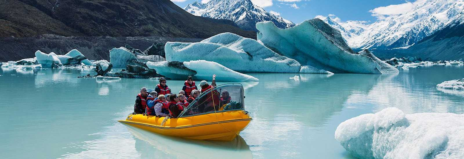 boat ride on an icy lake of mount cook national park