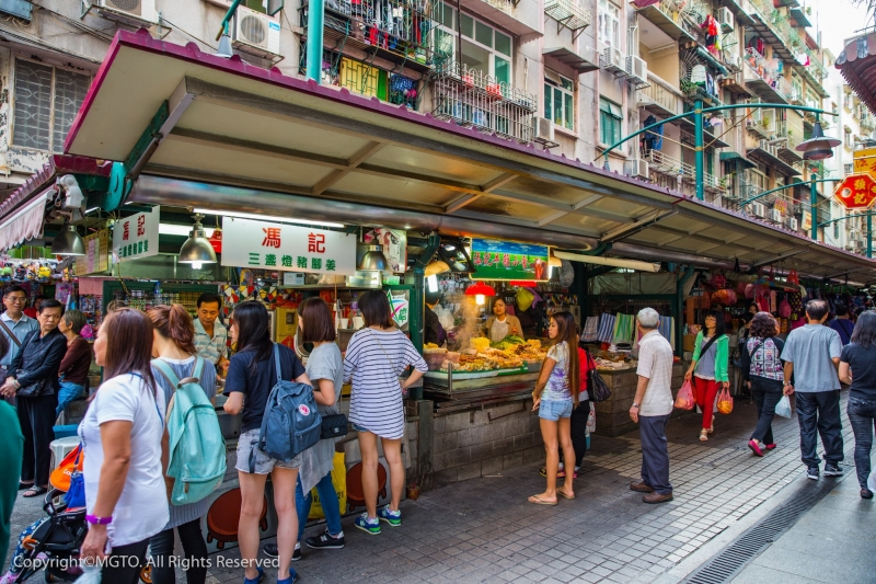 A crowded street with food stalls — Filipinos have to visit Macao for the street food!
