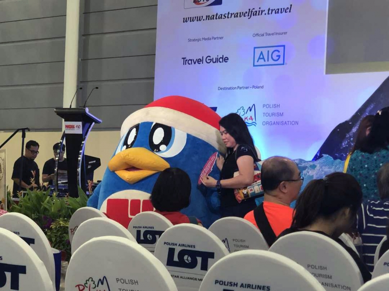 mascot photo-taking at natas travel fair