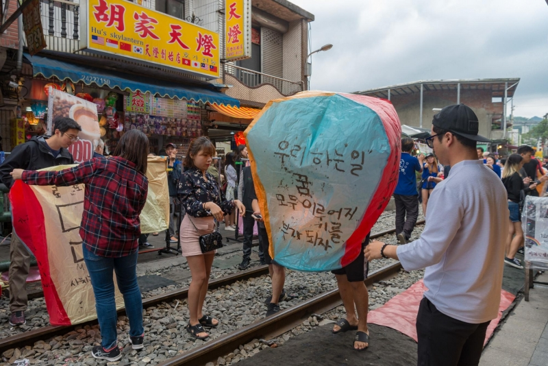 lighting sky lantern on the railway
