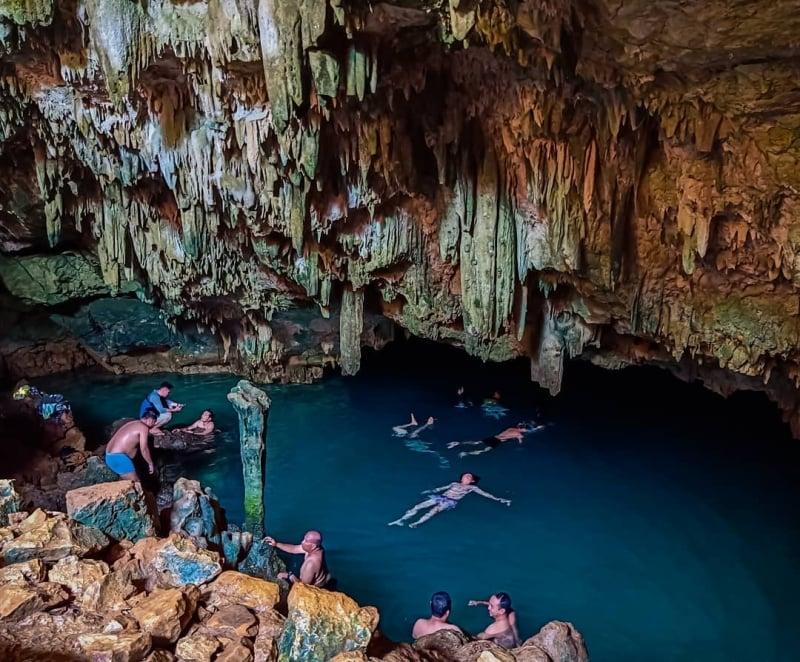 swimming in rangko cave