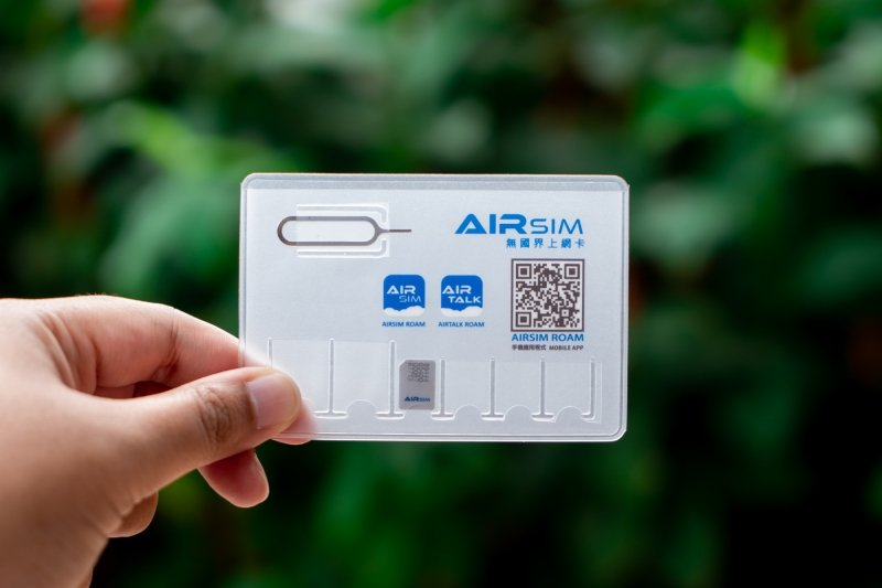 SIM ejector and SIM card adaptors in travel SIM card package