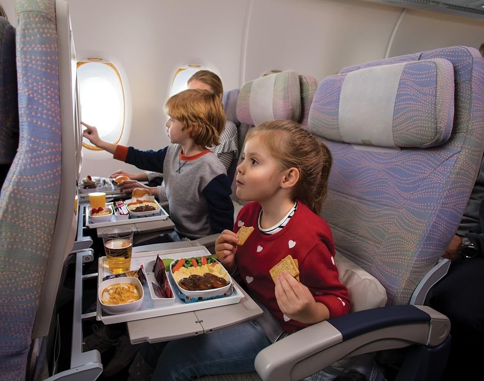 Kids with food on airplane
