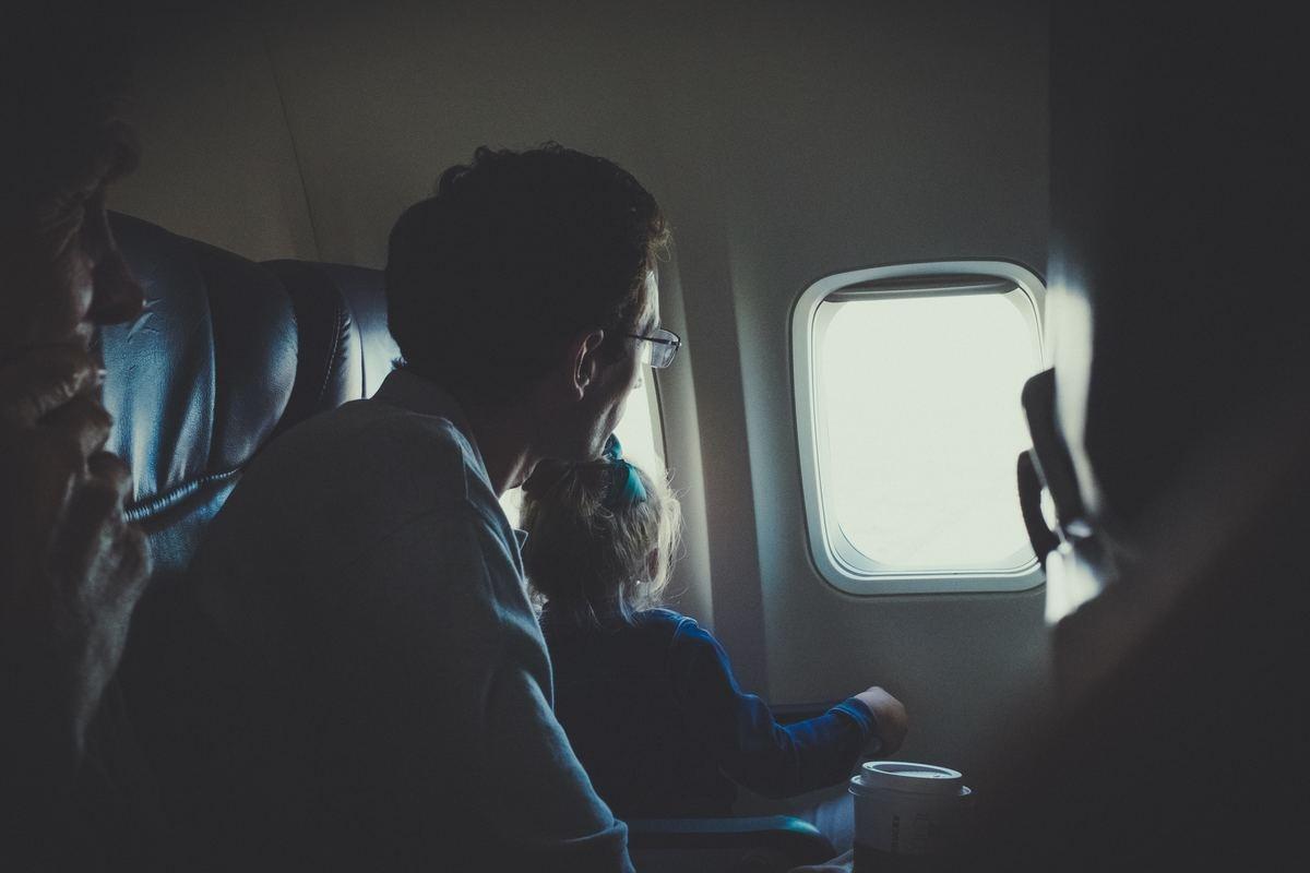 Kid looking outside plane