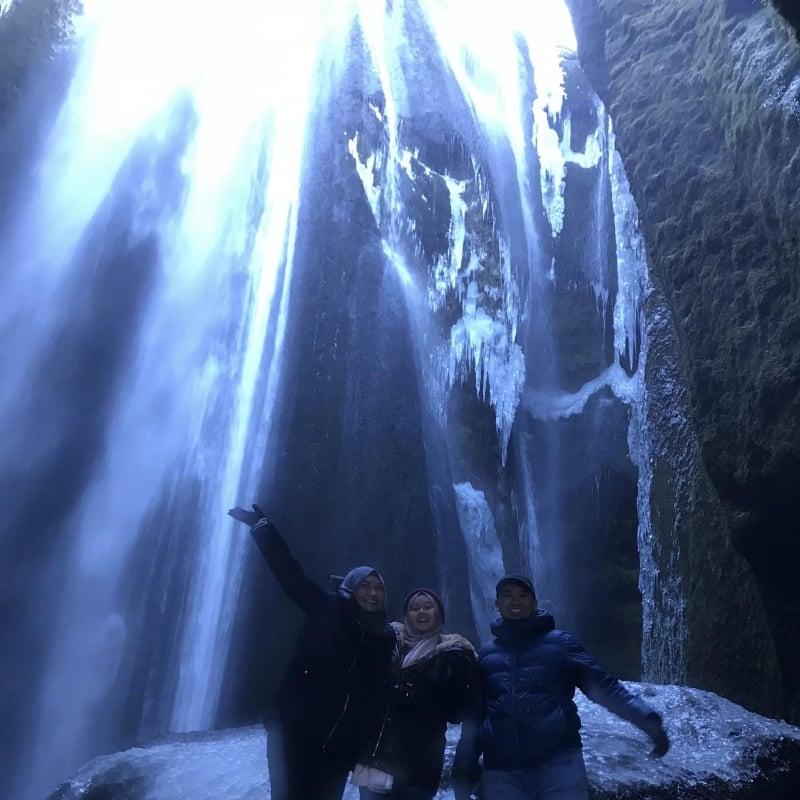 people at gljufrafoss waterfall