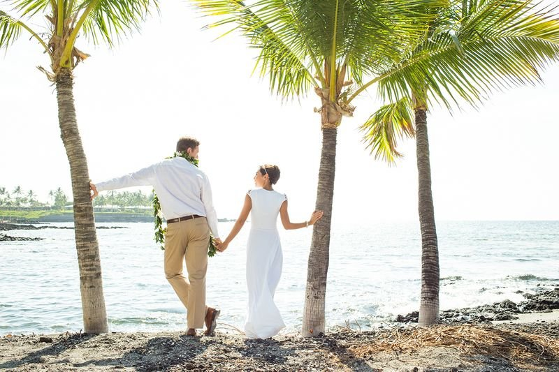 Newlywed couple enjoys time by the beach, Island of Hawaii