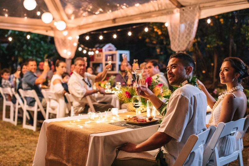 Guest toasts newlyweds at wedding reception, Maui, Hawaii