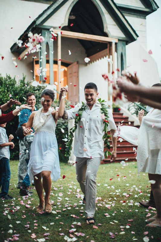 Newlyweds pass well-wishers after ceremony, Maui, Hawaii