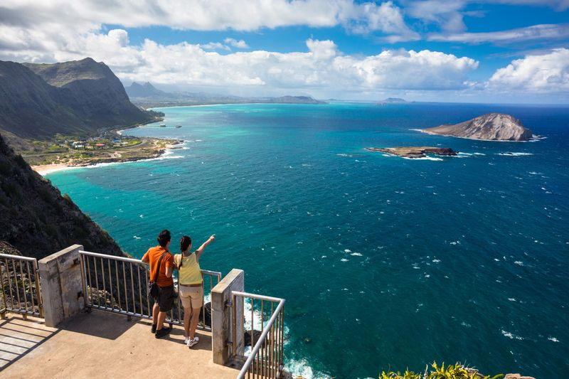 Couple looking from near Makapuu Lighthouse to Manana Island, Waimanalo, Oahu